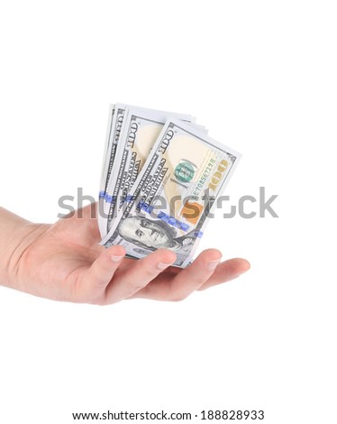 Heap of hundred dollar bills. Isolated on a white background. - stock photo
