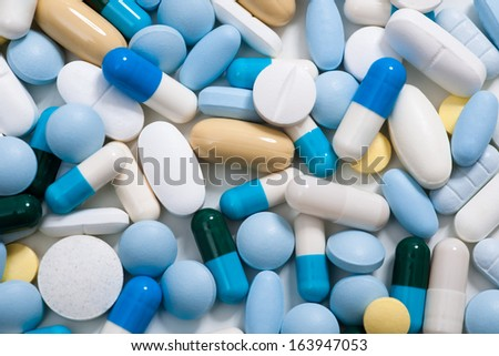 Heap of medicine pills.  Background made from colorful pills and capsules - stock photo
