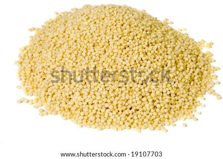 Heap of millet on white ground - stock photo