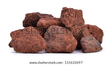 Heap of natural iron ore isolated on white background - stock photo