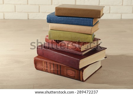 Heap of old books on floor close up - stock photo