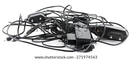 Heap of old cellular telephone chargers isolated on white background.   - stock photo
