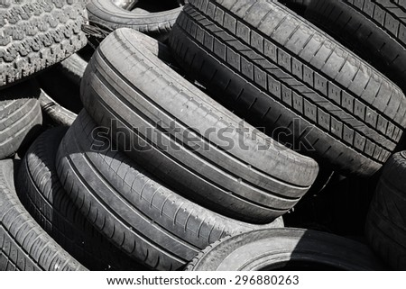 Heap of old used worn-out automotive tires - stock photo