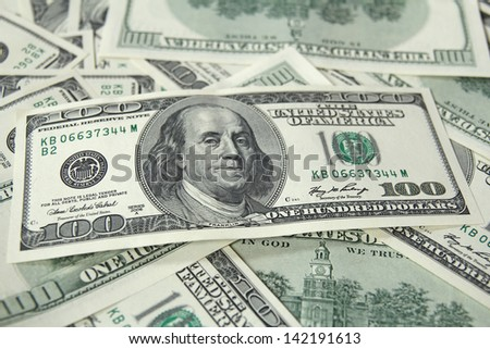 heap of one hundred dollar bills - stock photo