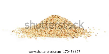 Heap of organic natural sesame seeds over white background - stock photo