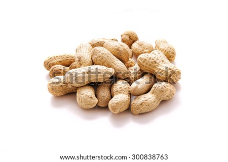 heap of peanuts in the shell over white background - stock photo