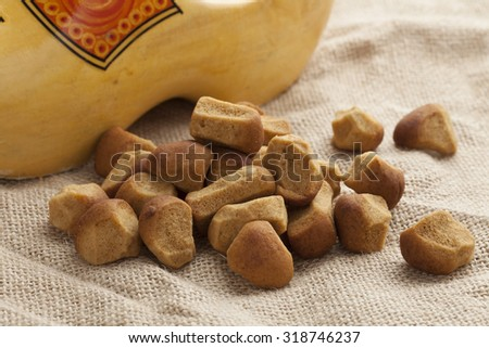 Heap of pepernoten on jute with a dutch wooden shoe - stock photo