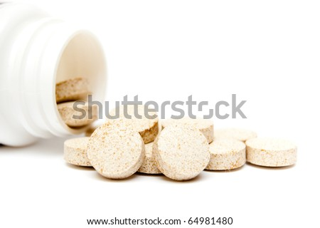 heap of pills and bottle on white - stock photo