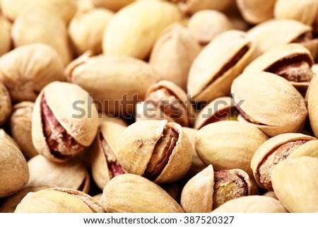 Heap of pistachios close-up. Shallow DOF! - stock photo