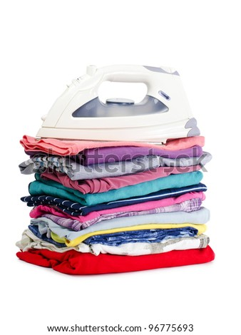 Heap of pure clothes with an iron - stock photo