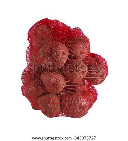 Heap of raw potatos in red string bag - stock photo