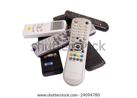 Heap of remote controls - stock photo