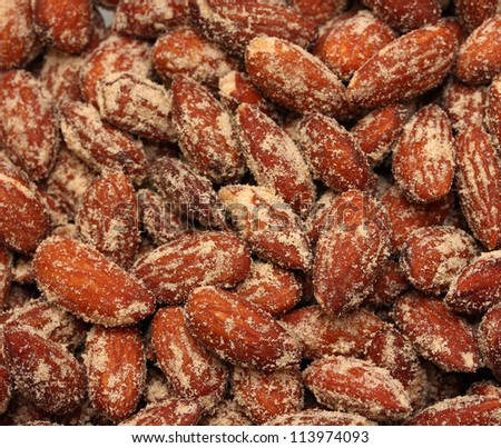 heap of roasted and salted almonds - stock photo