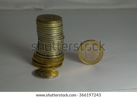 Heap of russian rouble coins and one euro coin. Russian economic crisis concept. - stock photo