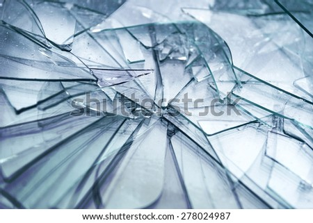 heap of shattered transparent glass with sharp edges - stock photo
