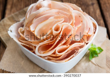Heap of sliced Chicken Breast Fillet (selective focus; close-up shot) - stock photo