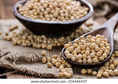 Heap of Soy Beans on wooden background - stock photo