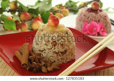 Heap of sweet rice and fruits on the plate - stock photo