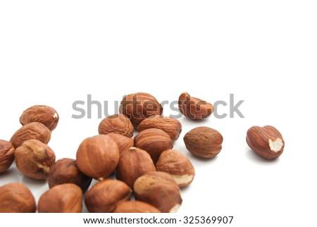 heap of tasty hazelnuts closeup on white background - stock photo