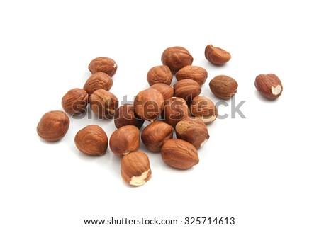 heap of tasty hazelnuts on white background closeup - stock photo