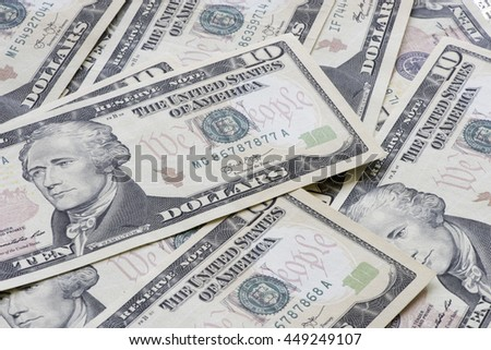 Heap of ten US dollar banknotes. - stock photo