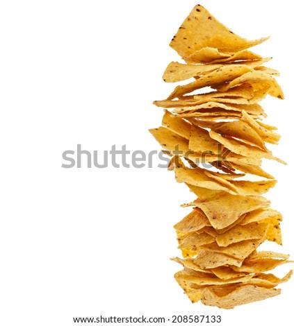 heap of tortilla nachos isolated on white background - stock photo