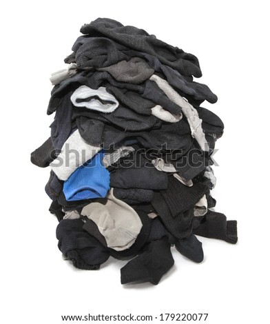 Heap of unsorted socks isolated over white - stock photo