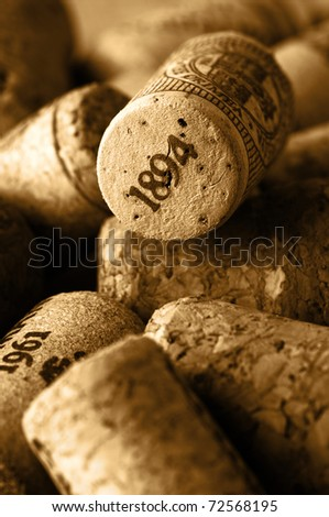 Heap of used vintage wine corks close-up. Toned image. - stock photo