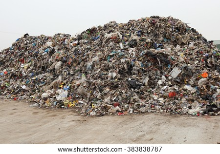 Heap of various mixed waste - stock photo