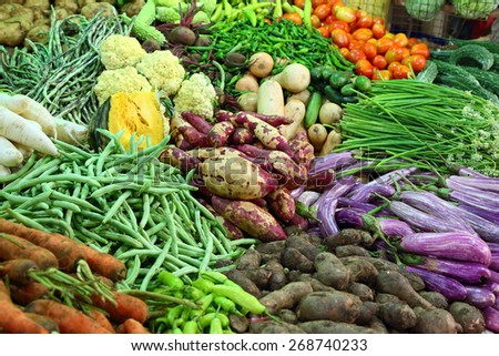 heap of various vegetables on market in asia - stock photo