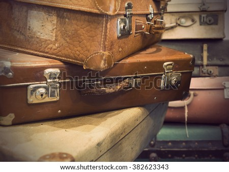 heap of vintage suitcases in sepia tone - stock photo