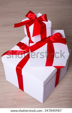 heap of white gift boxes on wooden background - stock photo