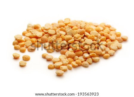 Heap of yellow dry peas - stock photo