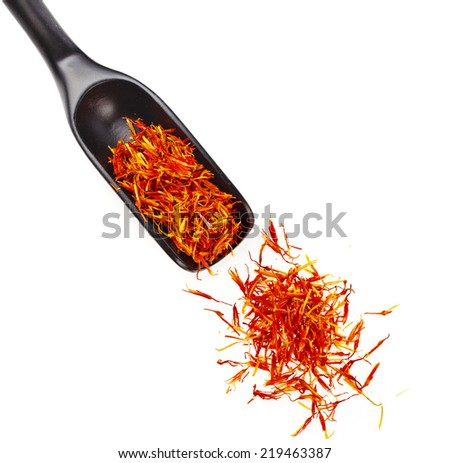 Heap pile of Saffron Stamens in black wooden scoop , isolated on white background - stock photo