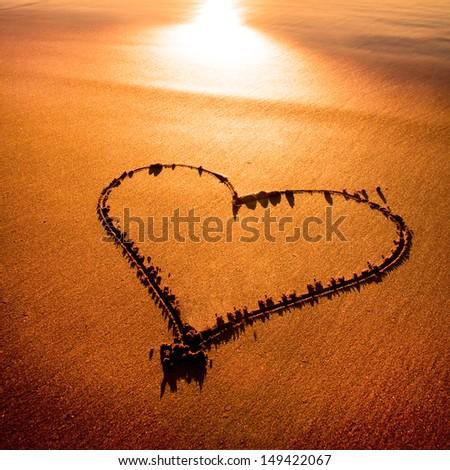 Heard drawn in the sand on the atlantic coast - stock photo
