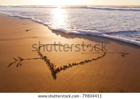 Heard drawn in the sand on the atlantic coast - stock photo