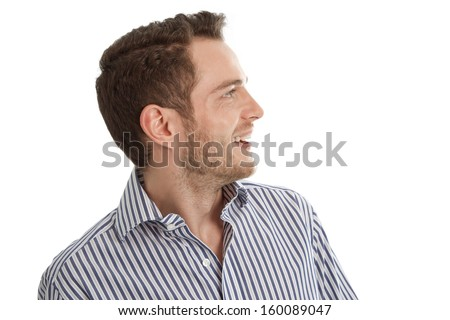 Hearing - Young man in blue shirt looking sideways isolated on white background - stock photo