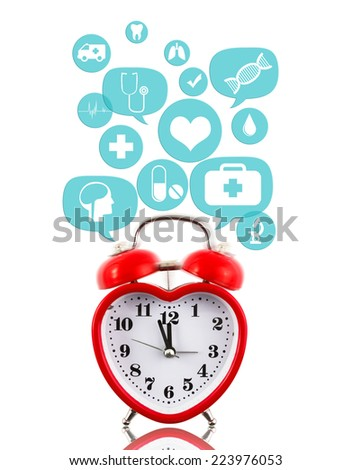 Heart alarm clock with medical icons in talk bubbles isolated - stock photo