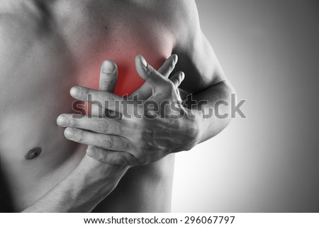 Heart attack. Pain in the human body.  Black and white photo with red dot - stock photo