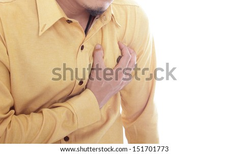 Heart Attack ,Use hand grabbing a chest with white background - stock photo