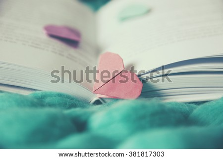 Heart bookmark for book on wicker blue fabric closeup - stock photo