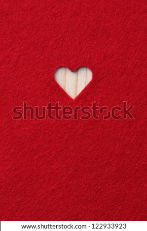 Heart carved in red felt. Background Valentine's Day - stock photo