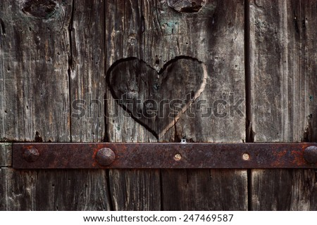 Heart carved in wood. Dark heart. Valentines day background - stock photo