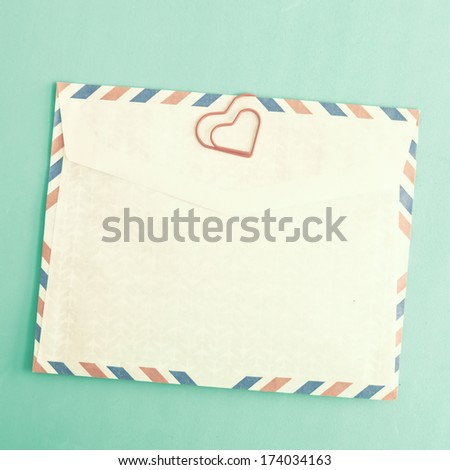 Heart clip and vintage envelopes - stock photo