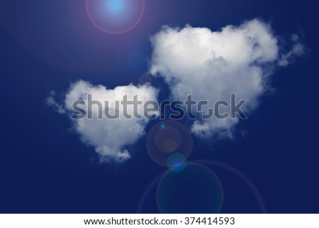 Heart clouds and blue sky. - stock photo