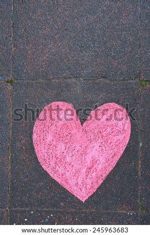 Heart drawn in chalk on the sidewalk - stock photo