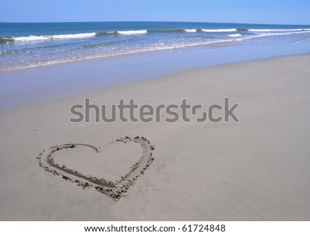 Heart drawn in the sand - stock photo