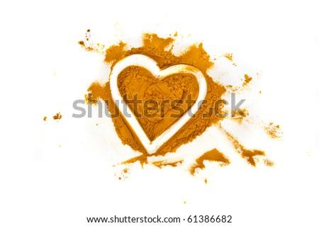 Heart drawn in turmeric - stock photo