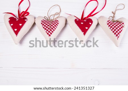 Heart fabric hand made on white wooden background - stock photo