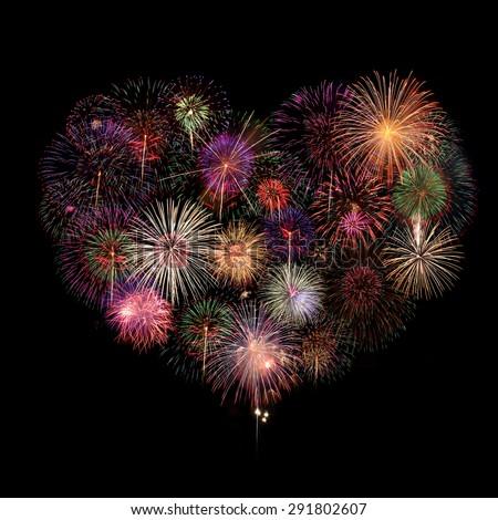 Heart Fireworks Celebration on black Background - stock photo